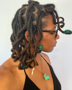 Loose Curls on Thick Locs with Green Hair Color Created By Pin Curls