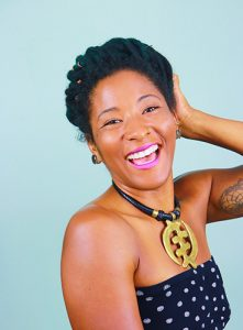 woman with locs in a halo hairstyle laughing